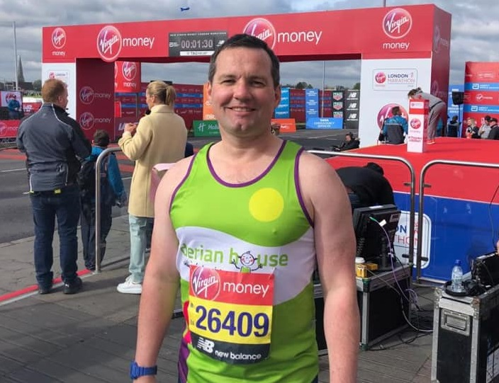 MP crosses the London Marathon finish line for Derian House