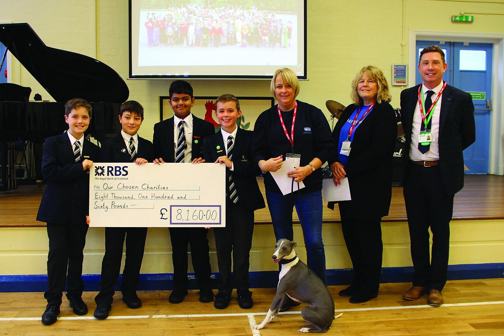 School donates £8000 to charities