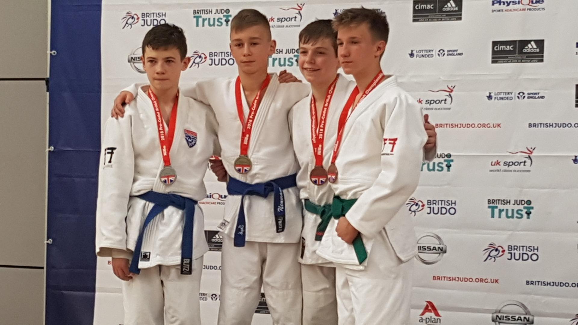 Jamie Death, second right, wins a judo bronze